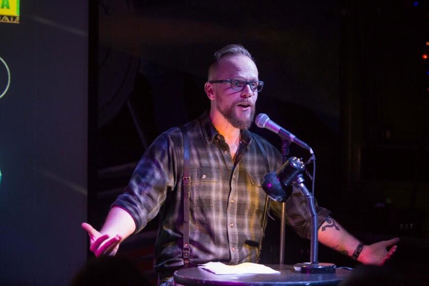 Justin Hudnall, executive director of So Say We All, tells a story,