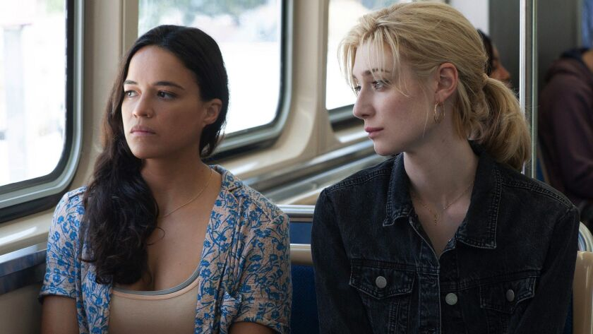 "(L-R) - Michelle Rodriguez and Elizabeth Debicki star in Twentieth Century Fox's ""WIDOWS."" Credit:"
