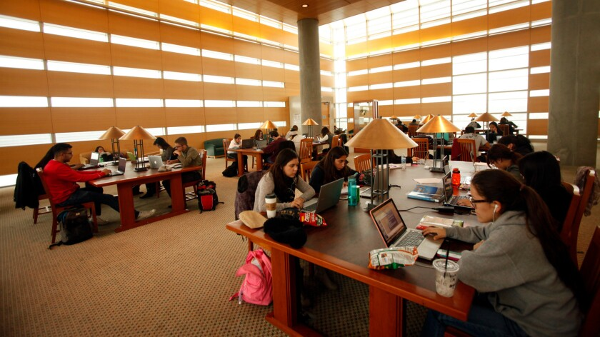Students study inside the Kolligian Library at UC Merced, which made the list of best national universities for the first time in rankings announced Tuesday by U.S. News and World Report.
