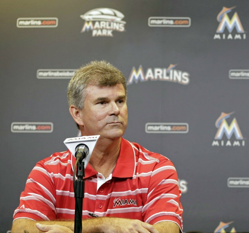 FILE - In this Sept. 29, 2013, file photo, Miami Marlins general manager Dan Jennings is shown during a news conference in Miami. Dan Jennings traded Dan Jennings. On the final day of the winter meetings, the Miami Marlins sent Jennings, a 27-year-old left-handed reliever, to the Chicago White Sox