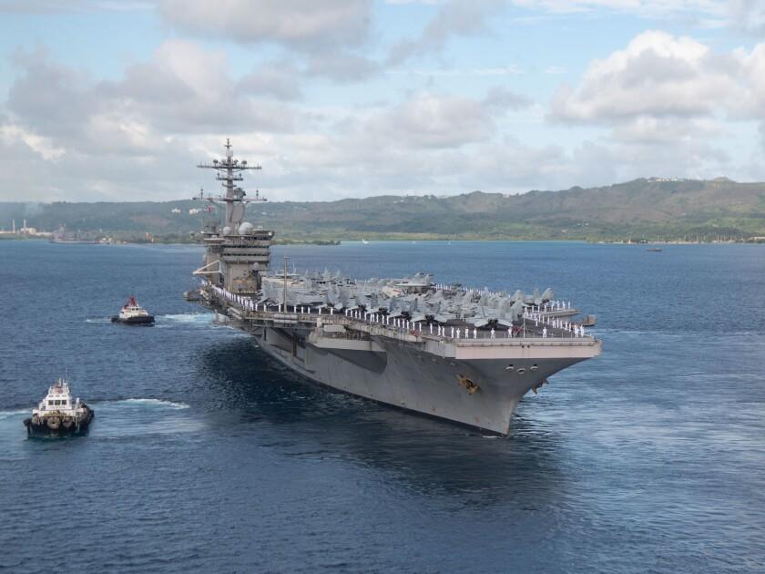 USS Theodore Roosevelt departs Apra Harbor, Guam, June 4.