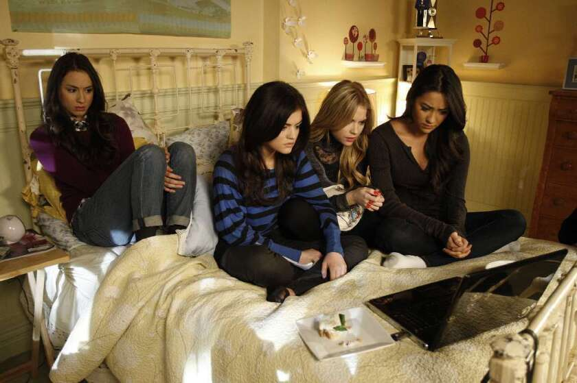 """Troian Bellisario, left, Lucy Hale, Ashley Benson and Shay Mitchell in a scene from ABC Family's """"Pretty Little Liars."""""""