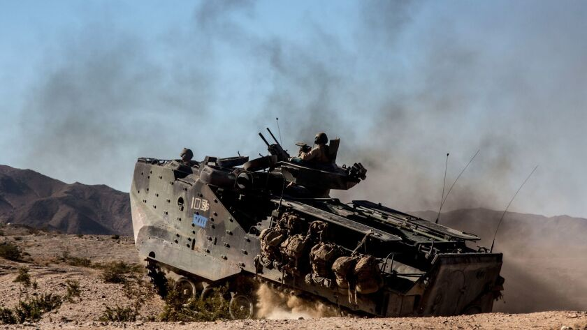 "A U.S. Marine Corps Amphibious Assault Vehicle maneuvers during a course at Twentynine Palms, Calif., on Aug. 9, 2017. Called an ""Amtrack"" by the troops, it's the armored amphibious workhorse of the Corps."