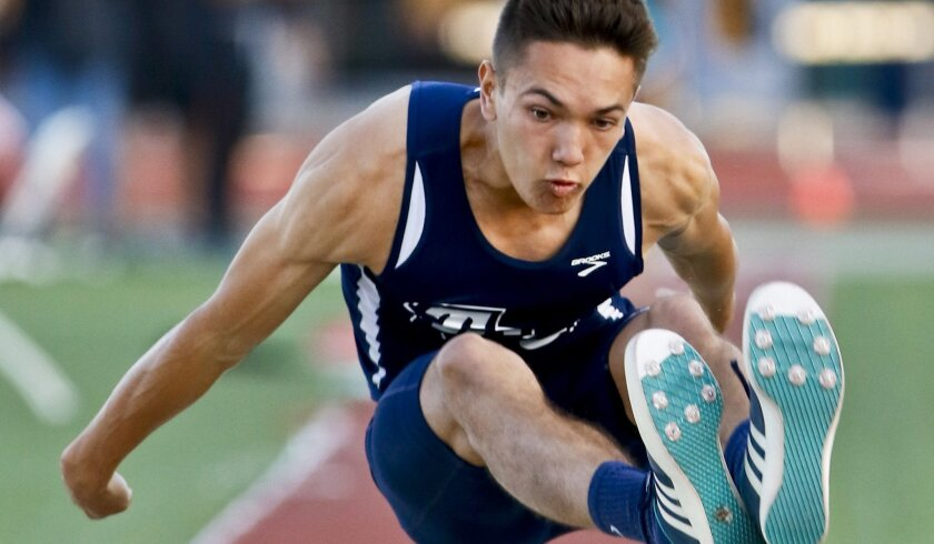 Tri-City Christian's Matt DeRoos competes in the long jump Friday night at the Escondido Invitational.