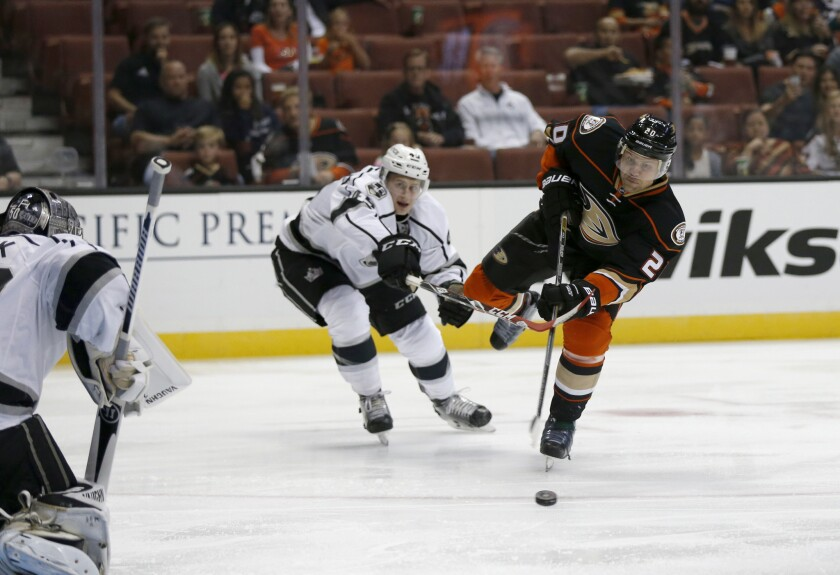 Kings defender Alex Lintuniemi, left, tries to block Ducks left wing Sean Bergenheim's shot on goal in the first period during a preseason game at Honda Center on Oct. 2.