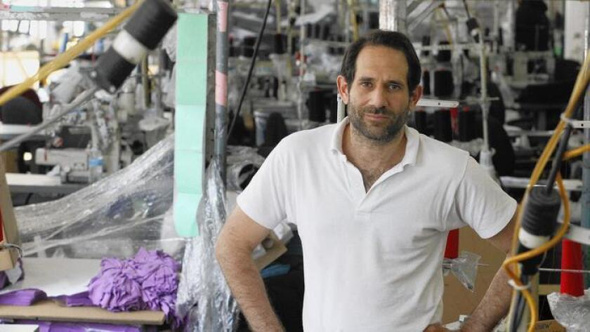 Dov Charney indicated in Tuesday security filings that he would solicit proxy support to regain control of American Apparel.
