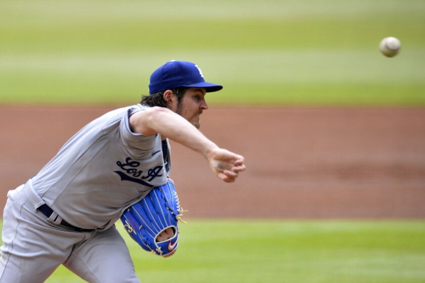 Trevor Bauer of the Los Angeles Dodgers spins a breaking ball against the Atlanta Braves on Sunday in Atlanta.