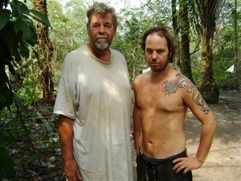 An undated handout photo provided by the Nigerian militant group Movement for the Emancipation of the Niger Delta (MEND) which they claim shows two British hostages being held in Nigeria's oil-rich delta region. In a written statement accompanying three pictures distributed Sunday, Jan. 11, 2009, M