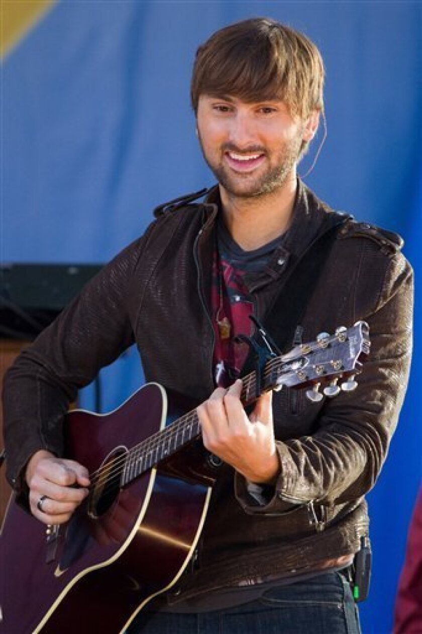 """Dave Haywood of Lady Antebellum performs in Central Park, on ABC's """"Good Morning America"""" show, in New York, Friday, Aug. 27, 2010. (AP Photo/Charles Sykes)"""