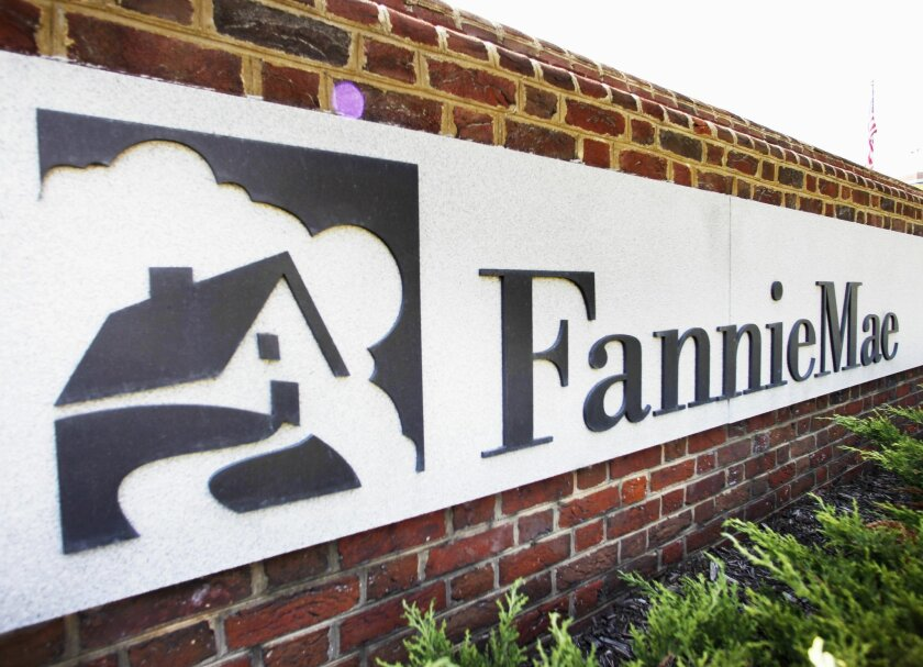 FILE - This Aug. 8, 2011 file photo shows the front of the Fannie Mae headquarters in Washington.  The mortgage giant  reported net income of $2 billion from July through September, 2015 down from $3.9 billion a year earlier. The results posted Thursday, Nov. 5, 2015 marked the 15th straight profit