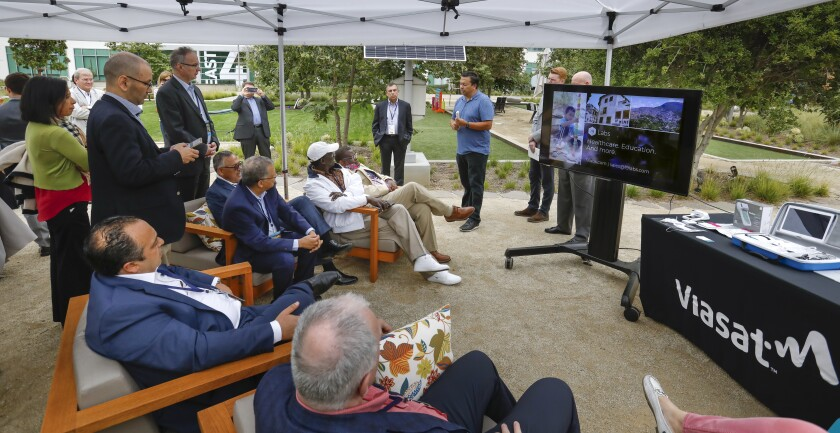 Keven Lippert, Viasat chief commercial officer addresses some of the more than 30 ambassadors from around the world who watched a telemedicine demonstration during a visit to the Viasat Carlsbad offices on Tuesday.
