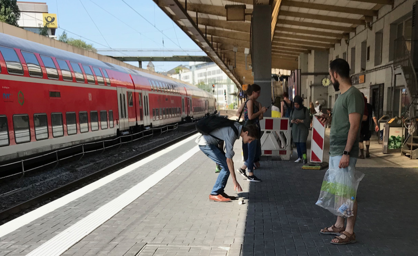 Paper cup experiment is carried out on German train platform
