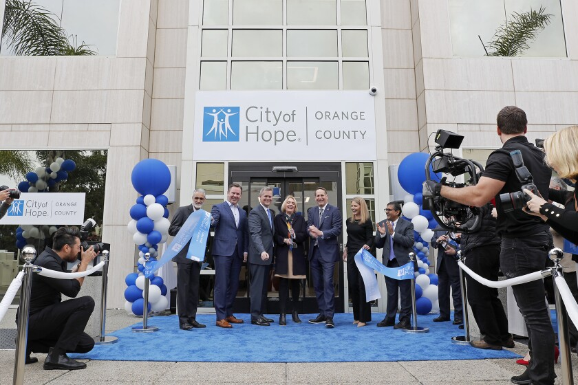 Officials attend a ribbon during the grand opening for City of Hope in Newport Beach.