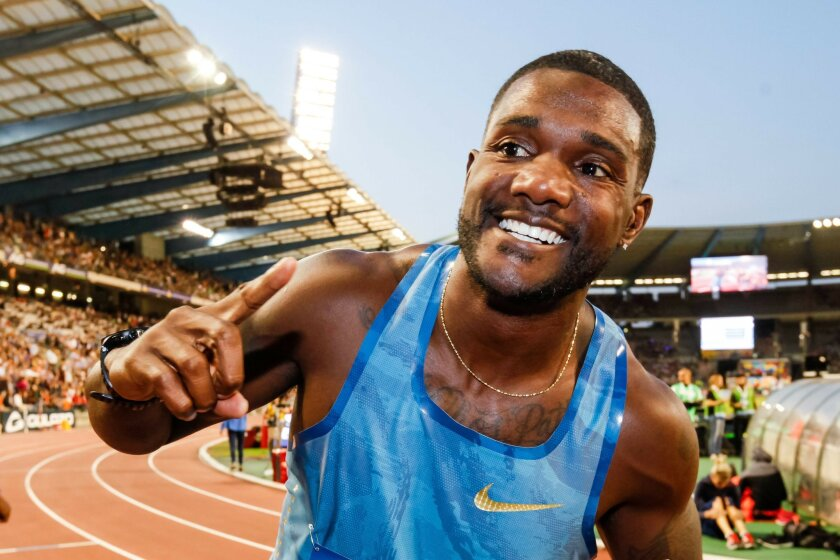 FILE - In this Sept. 11, 2015, file photo, Justin Gatlin, from the U.S., celebrates after winning the men's 100 meters at the Diamond League Memorial Van Damme athletics event at Brussels' King Baudouin stadium. Before a race, the mild-mannered American sprinter says he transforms himself into the