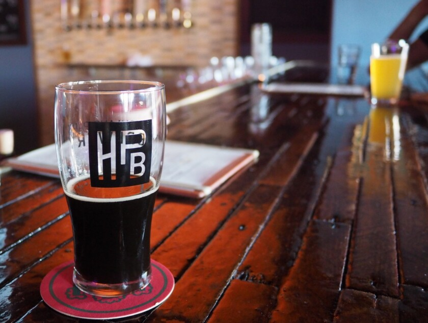 Pints at the original Highland Park Brewery, which will open a second location in Chinatown.