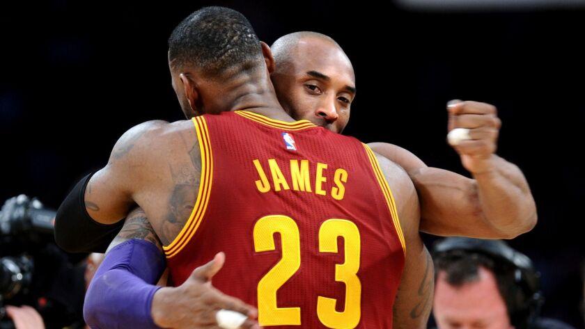 LOS ANGELES, CALIFORNIA MARCH 10, 2016-Lakers Kobe Bryant hugs Cavaliers LeBron James before the sta