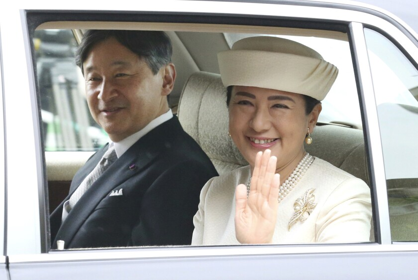 Japan's new Emperor Naruhito and Empress Masako are driven to the Imperial Palace in Tokyo on May 1, 2019. Naruhito ascended the Chrysanthemum Throne, succeeding his father, Emperor Emeritus Akihito, who abdicated the day before.