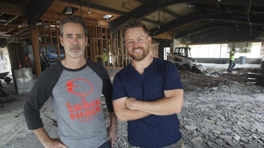 Crack Shack owner Michael Rosen, left, and chef/partner Richard Blais, stand inside what will be their new all-day chicken-and-egg restaurant, called the Crack Shack, in Encinitas. (Hayne Palmour IV)