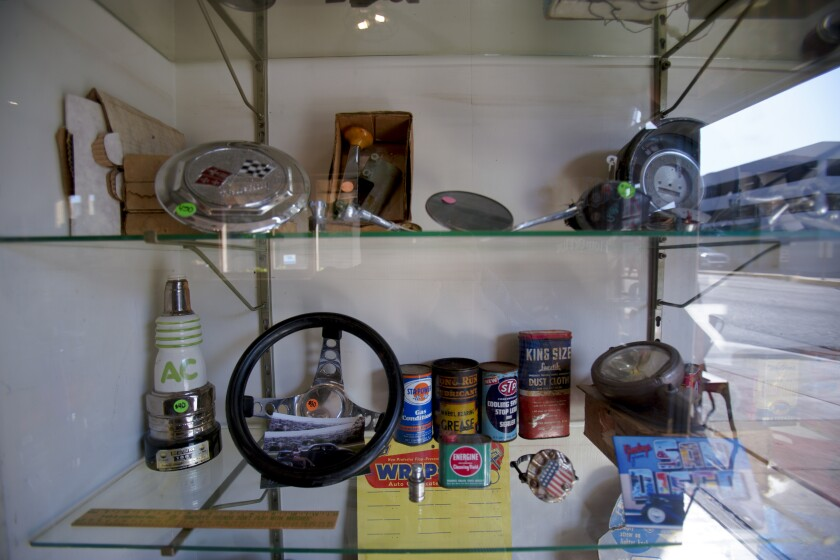 Antique car parts for sale are on display at Esquina Vintage & Coffee, which recently opened in National City.