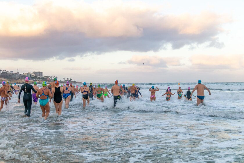 Contestants enter the water early on Sept. 29 for the 10-Mile Relay at La Jolla Shores.