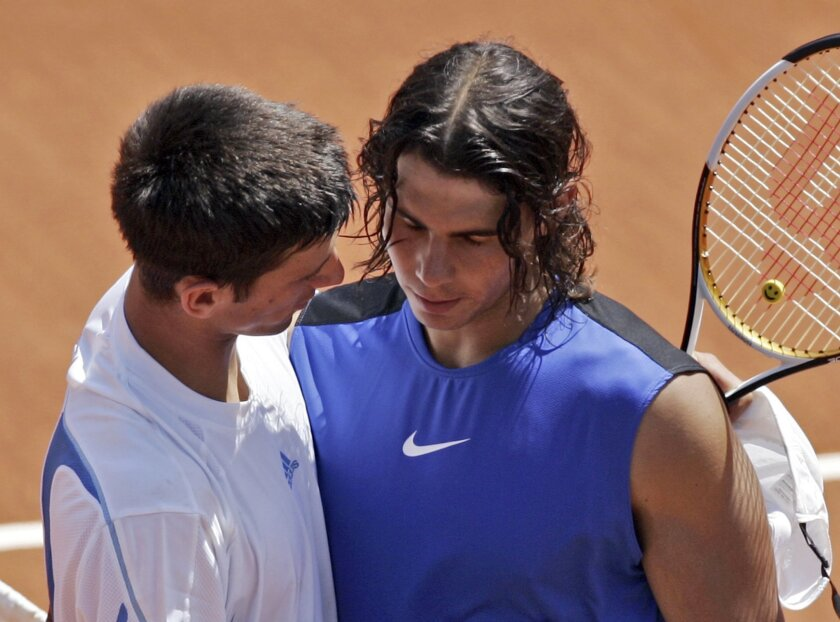 In this image taken Wednesday June 7, 2006, Spain's Rafael Nadal, right, shares a word with Serbia's Novak Djokovic at the net after Nadal won a quarter final match during the French Open tennis tournament at the Roland Garros stadium in Paris. Rafael Nadal and Novak Djokovic meet at the net after