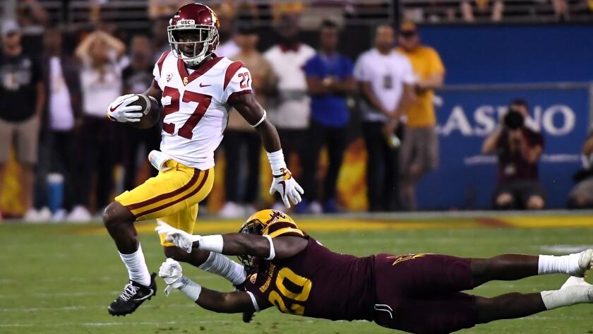 USC cornerback Ajene Harris breaks a tackle by Arizona State's Khaylan Thomas during a punt return Saturday.