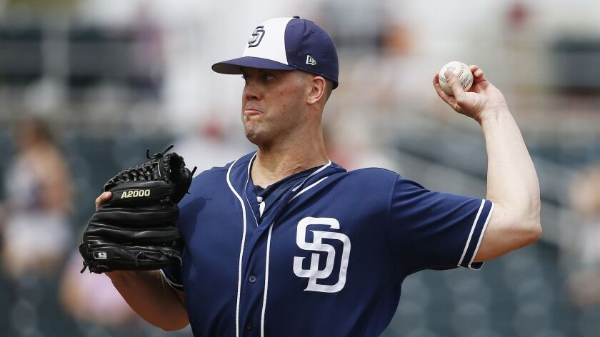 Padres starting pitcher Clayton Richard throws against the Cincinnati Reds during the first inning of a spring training game Saturday.