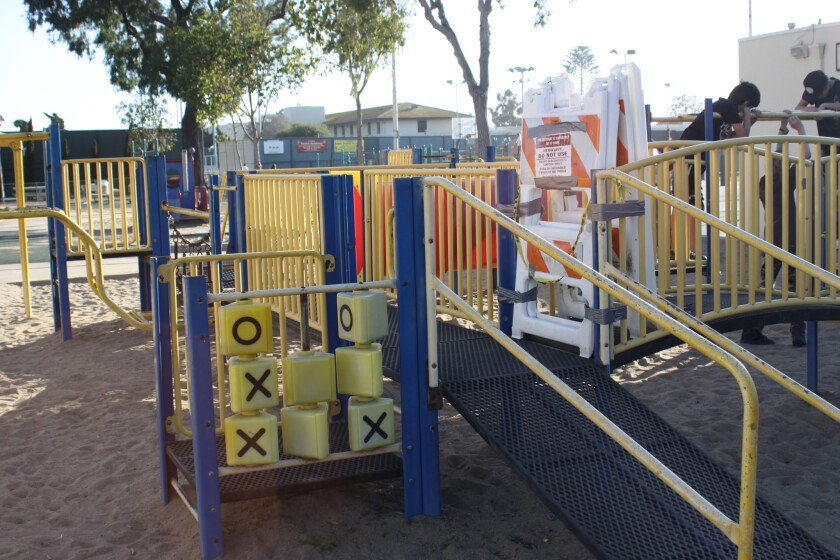 Some portions of the play structure are broken and signs advise against using it.