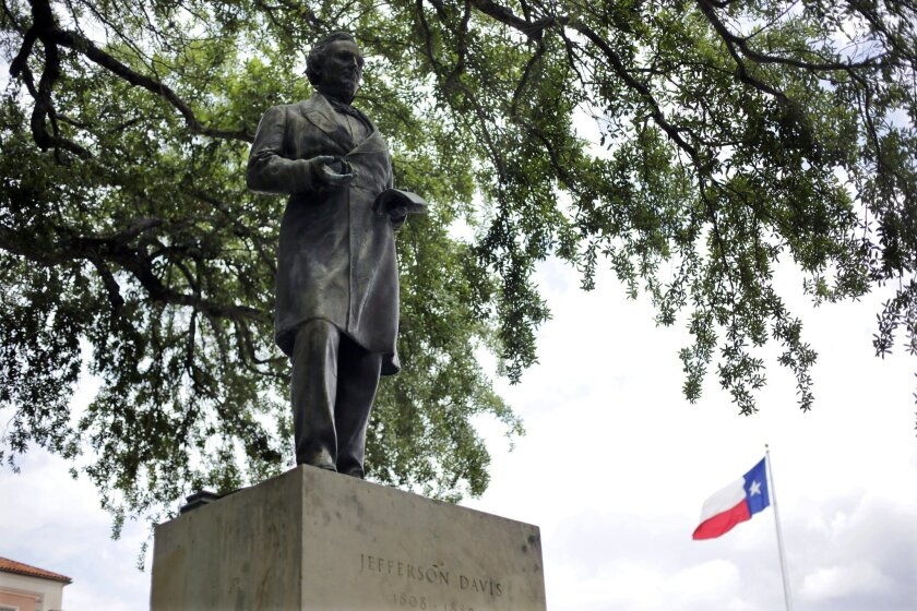 A statue of Jefferson Davis is seen on the University of Texas campus, Tuesday, May 5, 2015, in Austin, Texas. As University of Texas administrators consider a request to remove a statue that symbolizes the Confederacy, the number of memorials in Texas honoring the Confederate cause and its leaders