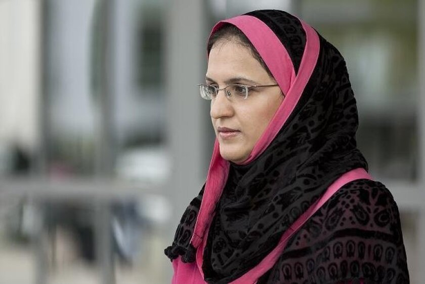Irum Abbasi fields questions from reporters at San Diego International Airport's Terminal 1 on Wednesday, March 16, 2011. She had been removed from a Southwest Airlines flight to San Jose while wearing her headscarf on Sunday, March 13, 2011.