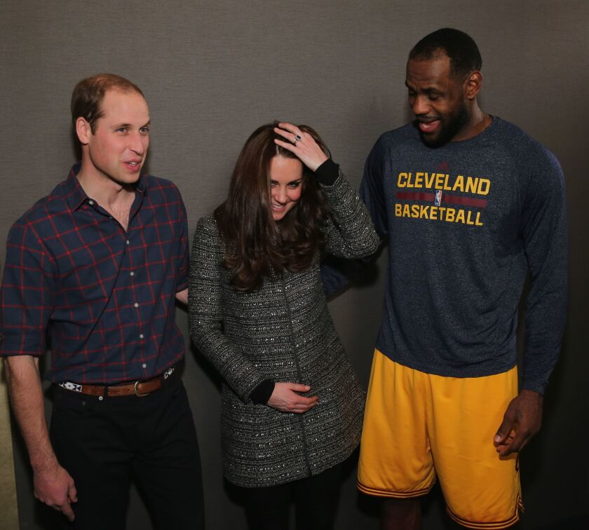 Prince William, Duke of Cambridge and Catherine, Duchess of Cambridge pose with LeBron James (R) backstage as they attend the Cleveland Cavaliers vs. Brooklyn Nets game at Barclays Center on December 8, 2014 in the Brooklyn borough of New York City.