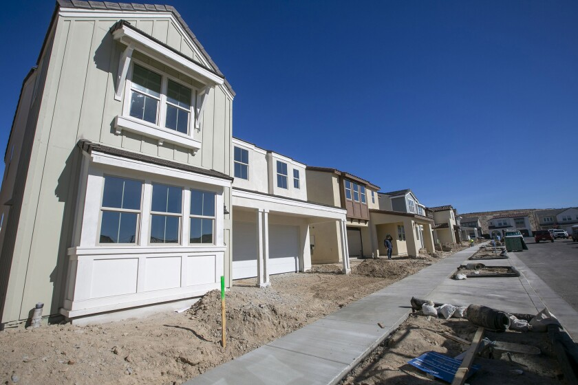 Newly completed single family homes getting finishing touches in the Seville project in Chula Vista on Friday, January 31, 2020.
