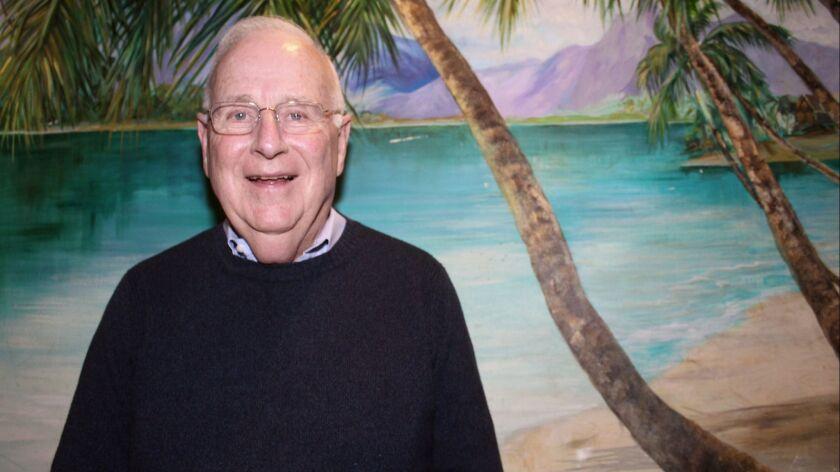 Steve Hunt, Glendale Historical Society president, pauses in front of one of Damon's several tiki-th