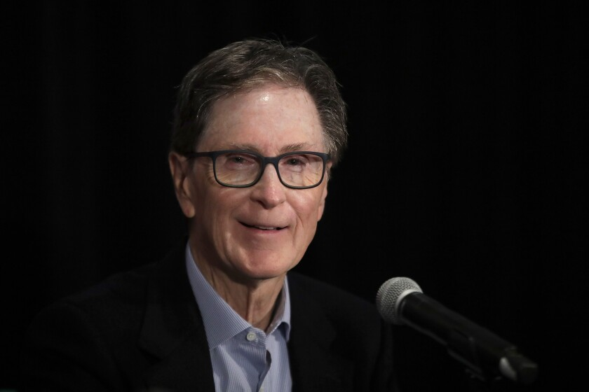 Boston Red Sox principal owner John Henry speaks at a news conference.