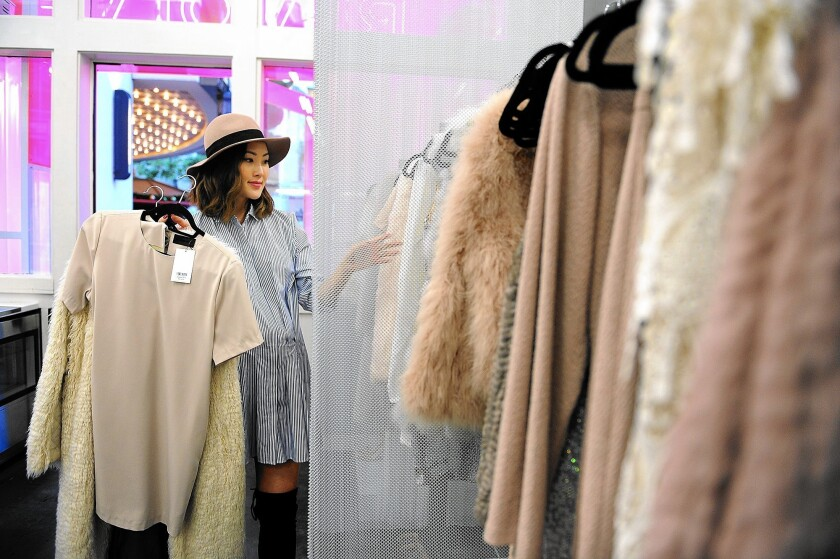 """Chriselle Lim shops at Revolve Clothing at the Grove shopping center after being asked to help promote the """"pop-up"""" store last month."""