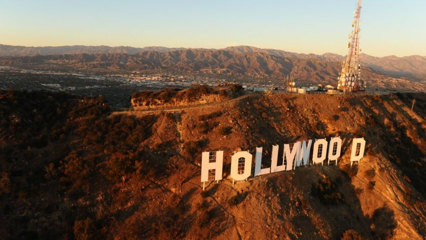 An aerial view of the Hollywood sign atop Mount Lee in Griffith Park.