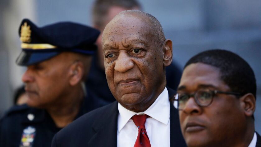 Bill Cosby, center, leaves the the Montgomery County Courthouse after being convicted of drugging an