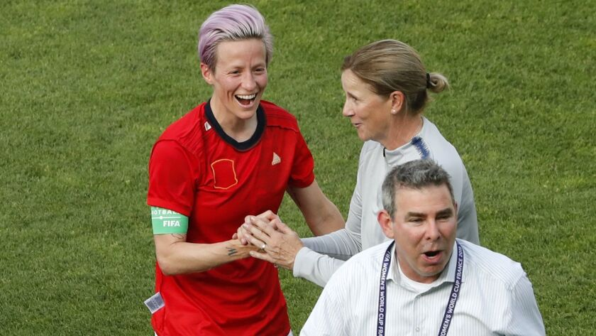 United States' Megan Rapinoe, left, celebrates with United States coach Jill Ellis at the end of the