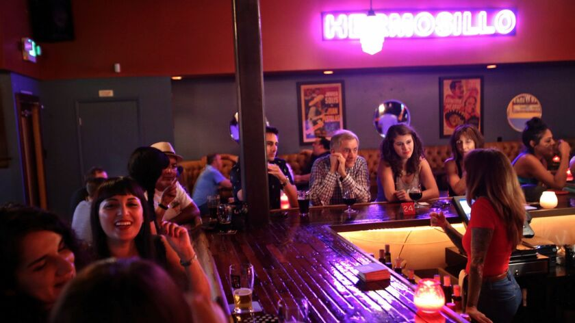 LOS ANGELES, CA - OCTOBER 3, 2015 -- Bartender Giulianna Lomaglio, right, tends to her customers at