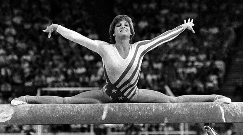 Mary Lou Retton performs on the balance beam in 1984.