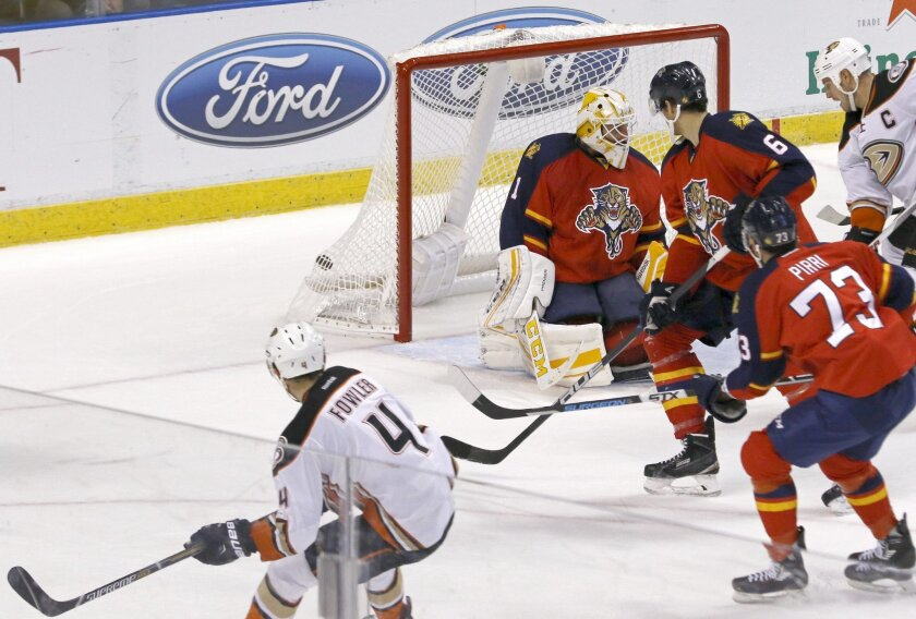 Anaheim Ducks defenseman Cam Fowler (4) watches his second-period goal againstFlorida Panthers goalie Roberto Luongo (1) during an NHL hockey game Thursday, Nov. 19, 2015, in Sunrise, Fla. (AP Photo/Joe Skipper)