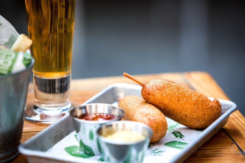 Chef Robert Gaffney's vegan Sriracha corn dogs are among a handful of vegan items now on the menu at Bagby Beer Company in Oceanside.
