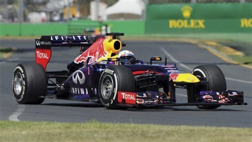 Red Bull driver Sebastian Vettel of Germany steers his car during the first practice session for Sunday's Australian Formula One Grand Prix at Albert Park in Melbourne, Australia, Friday, March 15, 2013. (AP Photo/Andrew Brownbill)