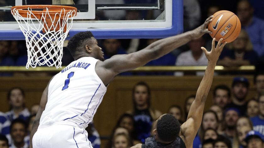 Duke's Zion Williamson blocks a shot by Army's Josh Caldwell in the Blue Devils' 94-72 victory last week.