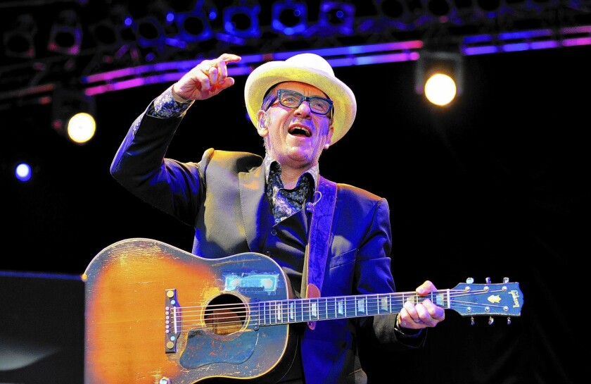 Elvis Costello, seen here in July in London, is working on new arrangements for his performances this week with the Los Angeles Philharmonic at the Hollywood Bowl.