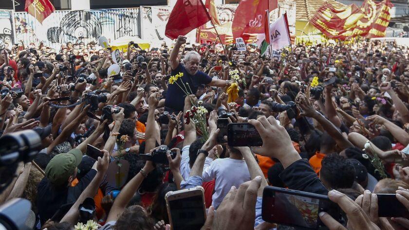 Brazilian ex-President Luiz Inacio Lula da Silva raises his fist after attending a Catholic Mass in memory of his late wife, Marisa Leticia, at the Steelworkers Union building in Sao Bernardo do Campo, in metropolitan Sao Paulo, Brazil, on April 7, 2018.