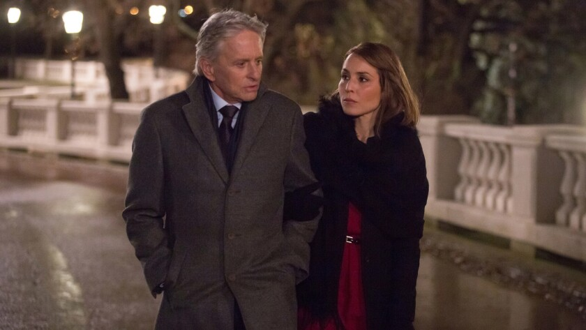 "Michael Douglas and Noomi Rapace in the movie ""Unlocked."""