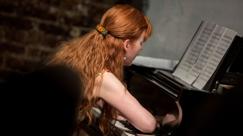 Pianist Sarah Cahill uses her forearm, part of the technique required to play Lou Harrison's piano music in a tribute to the composer at Monk Space on Tuesday night.