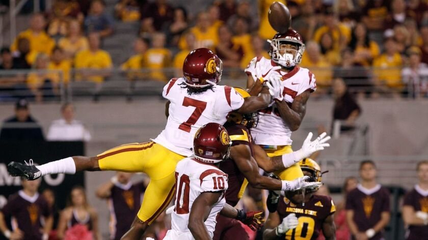 USC defensive backs Marvell Tell III (7) and Jack Jones and the Trojans' passing defense were up to the task last week against Harry N'Keal, center, and Arizona State. On Saturday, it's their run defense that figures to be tested.