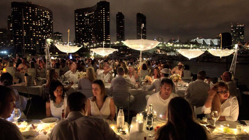 White-clad diners at the 2015 Le Diner en Blanc on the grass at Seaport Village in downtown San Diego.